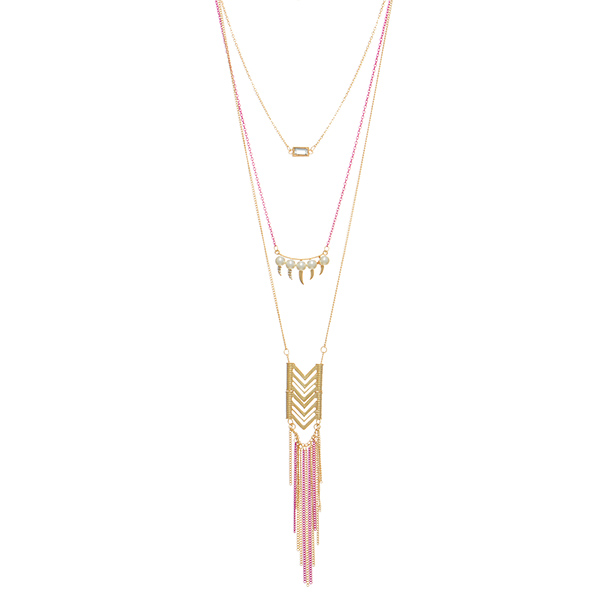 "Gold tone layering necklace set featuring a fuchsia chain with a clear stone,faux pearls, a chevron casting and metal fringe. Approximately 29"" in length."