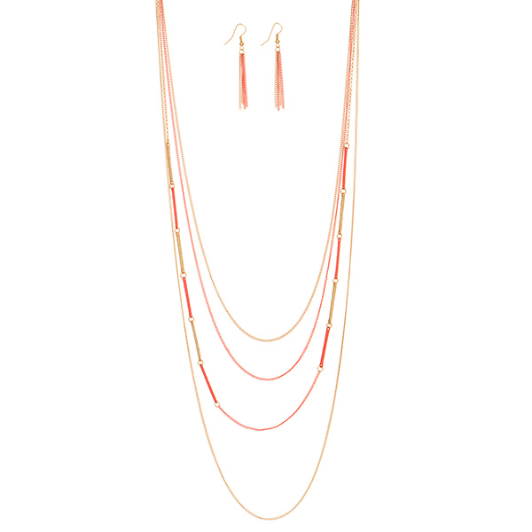 "Gold tone layering necklace set featuring a coral chain. Approximately 40"" in length."