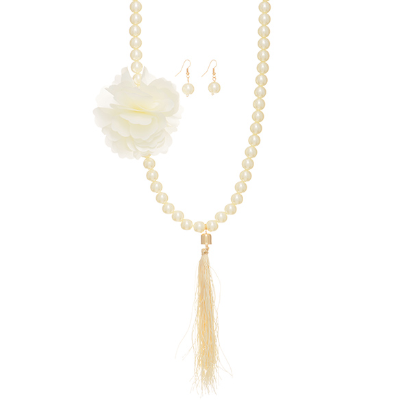 "Cream faux pearl necklace with a large flower and tassel accent. Approximately 50"" in length.  Can be doubled over into a layered look."