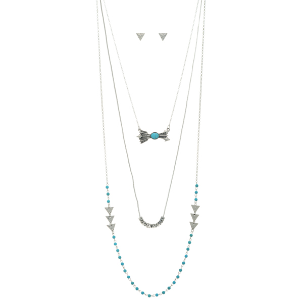 """Silver tone layering necklace set featuring turquoise beads, arrows, and hammered triangles. Approximately 34"""" in length."""