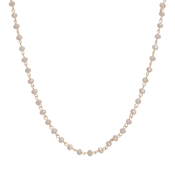 """Gold tone layering necklace set featuring ivory glass beads. Approximately 62"""" in length."""