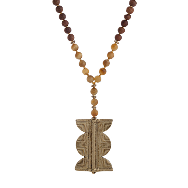 """Burnished gold tone half beaded necklace displaying yellow and brown wood beads with a 2 1/2"""" gold tone pendant. Approximately 35"""" in length. Handmade in the USA."""