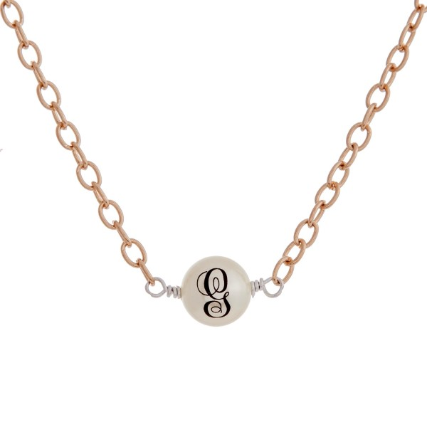 "Gold tone necklace with a wire wrapped fuax ivory pearl monogrammed with the initial G. Approximately 14"" in length."