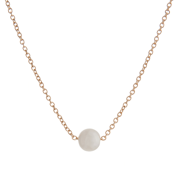 "Dainty gold tone necklace with a single faux ivory pearl. Approximately 16"" in length."