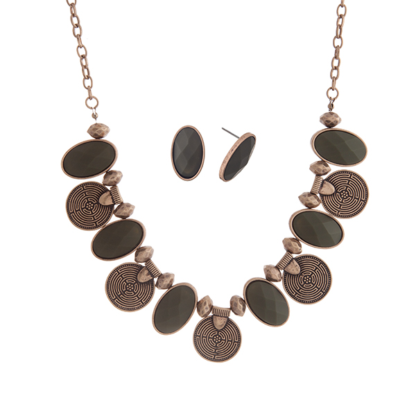 """Burnished gold tone bohemian inspired necklace set with olive oval shaped cabochons. Approximately 17"""" in length."""