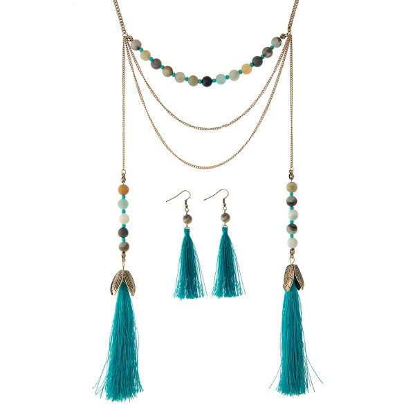 """Gold tone necklace set displaying amazonite beads with two 3 1/2"""" teal tassels at the end. Approximately 28"""" in length."""