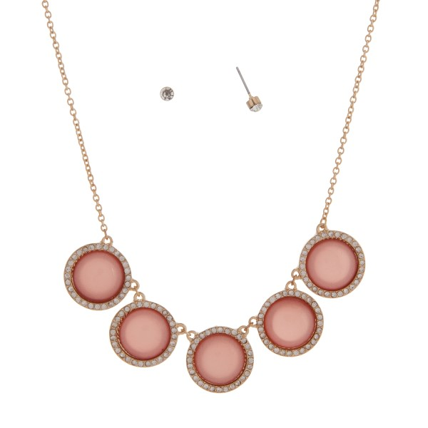 Wholesale gold necklace set displaying five shimmering pink disk halo
