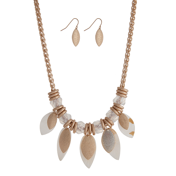 "Gold tone necklace set displaying metal ring and white beads with dangling ivory shell leaves. Approximately 20"" in length."