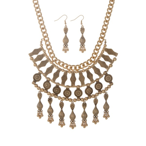 """Gold tone bohemian inspired necklace set with dangling charms. Approximately 19"""" in length."""
