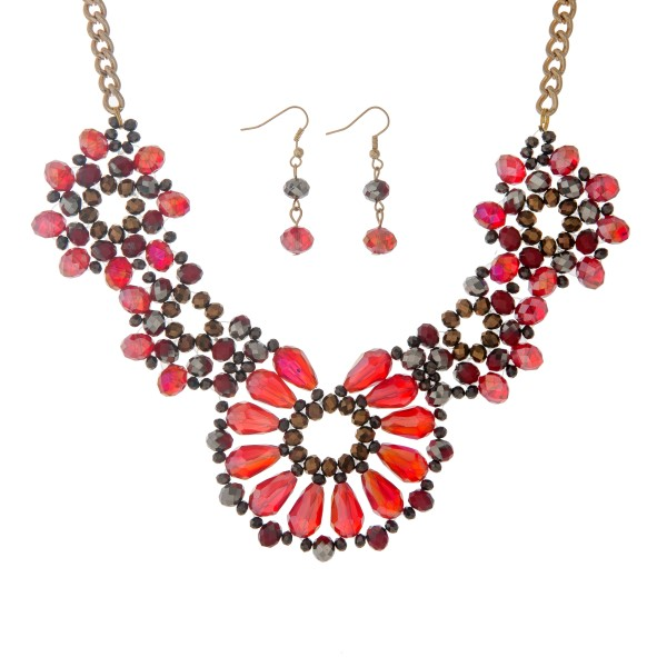 "Gold tone necklace set displaying a floral shape with red, gray, and brown glass beads. Approximately 15"" in length."