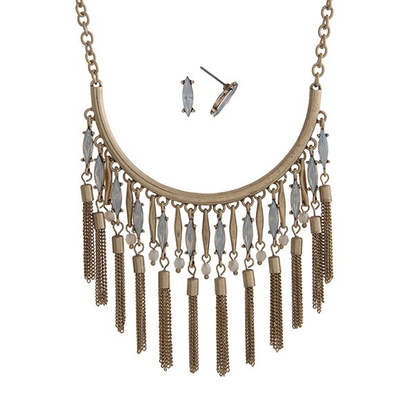 """Worn gold tone necklace set displaying a curved bar with hanging white opal pointed oval stones and chain tassels. Approximately 18"""" in length."""