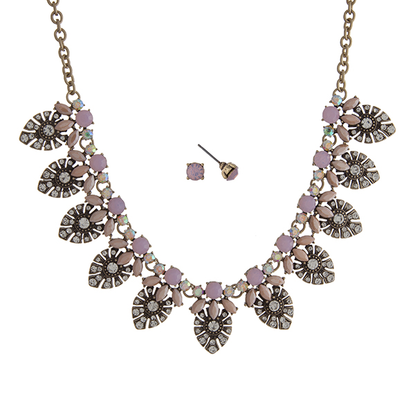 """Worn gold tone necklace set displaying pave teardrop shape castings with iridescent and pink cabochons. Approximately 17"""" in length."""