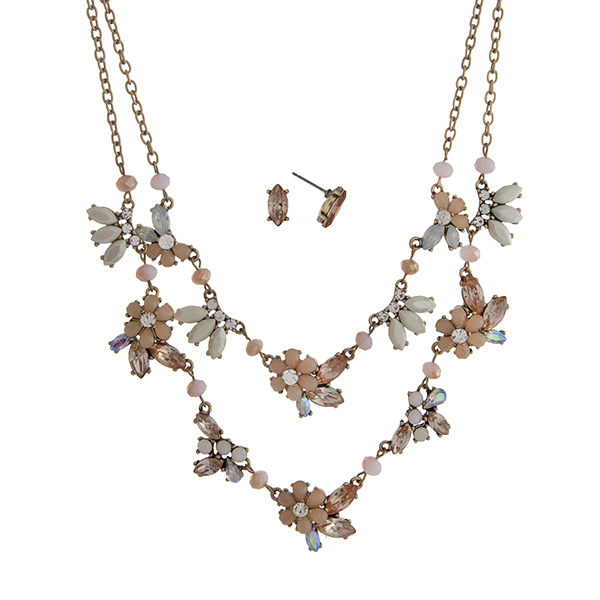 "Worn gold tone layering necklace set displaying peach and ivory flowers with iridescent and peach rhinestone accents. Approximately 20"" in length."