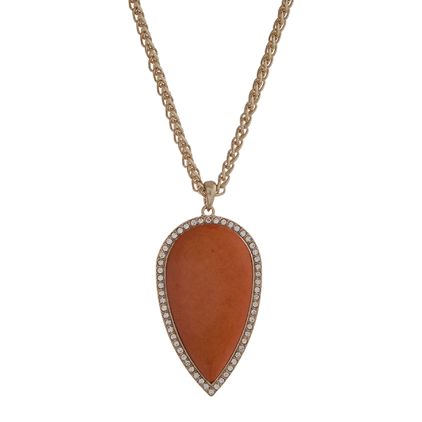 "Gold tone necklace with a 2 1/2"" orange teardrop shape stone pendant with rhinestone accents. Approximately 32"" in length."