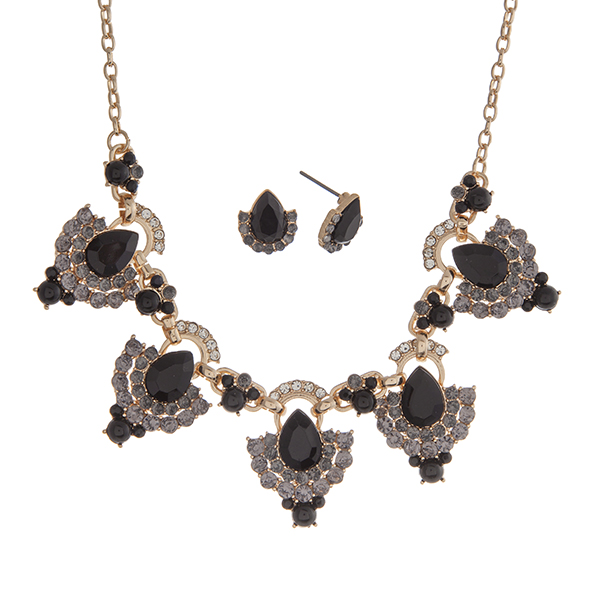 "Gold tone necklace set displaying black teardrop shape cabochons surrounded by rhinestones. Approximately 18"" in length."