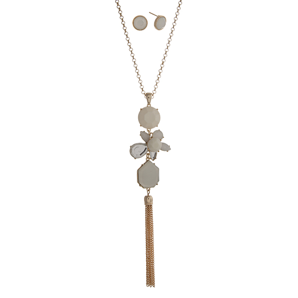 """Gold tone necklace set displaying a linked multiple shape ivory pendant with a 3"""" chain tassel. Approximately 29"""" in length."""
