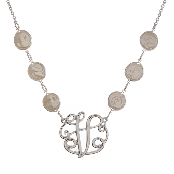 "Silver tone necklace with freshwater pearl beads and a 'V' script initial. Approximately 18"" in length."