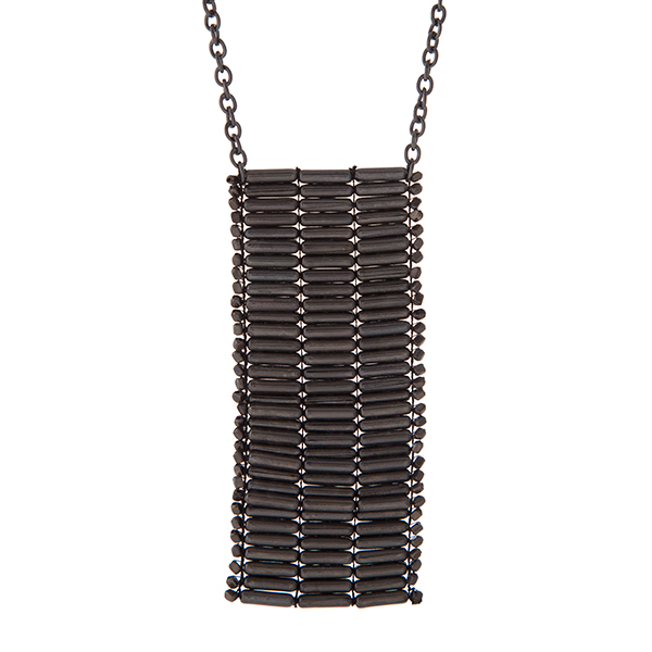 """Hematite tone necklace with a beaded pendant. Approximately 32"""" in length."""