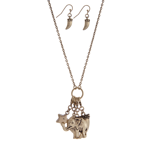"""Burnished gold tone necklace set with a charm cluster pendant featuring elephant, horn, star and flower charms. Approximately 30"""" in length."""
