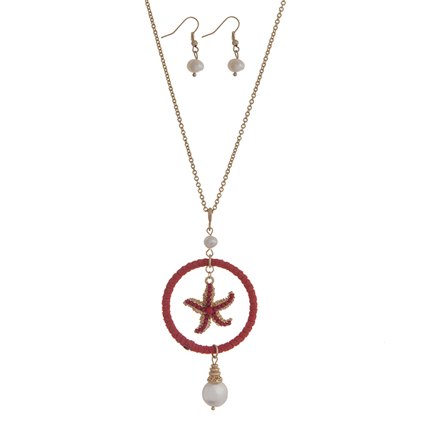 "Gold tone necklace set with a coral suede wrapped circle and starfish pendant accented with Mother of Pearl beads. Approximately 32"" in length."