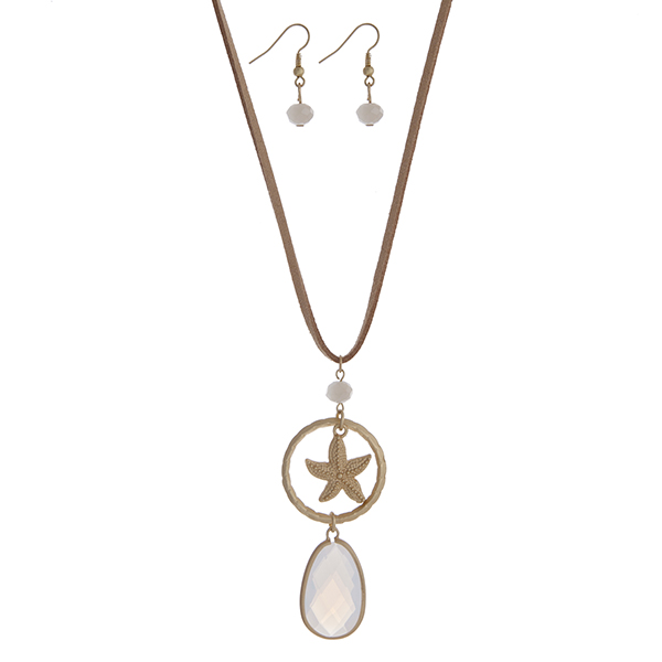 "Beige cord necklace set with a gold tone starfish and white opal pendant. Approximately 32"" in length."