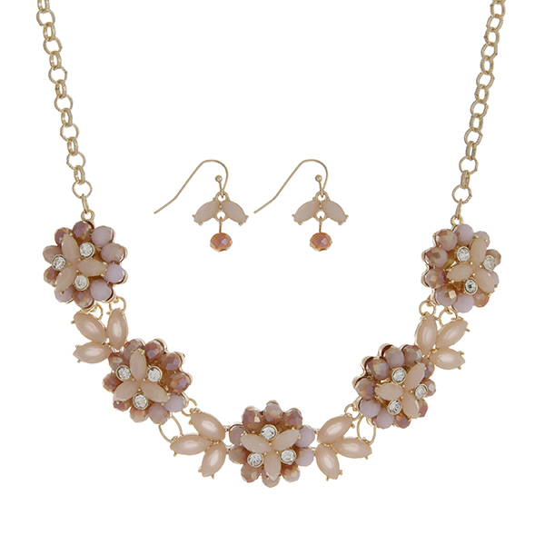 "Gold tone necklace set featuring five peach glass stone flowers accented by clear rhinestones. Approximately 18"" in length."