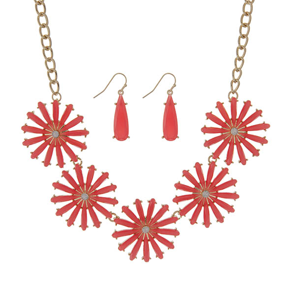 "Gold tone necklace set featuring five bright coral epoxy flowers. Approximately 18"" in length."