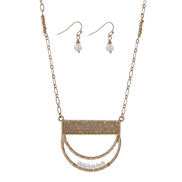 """Gold tone necklace set featuring a half circle pendant accented with white opal beads. Approximately 32"""" in length."""