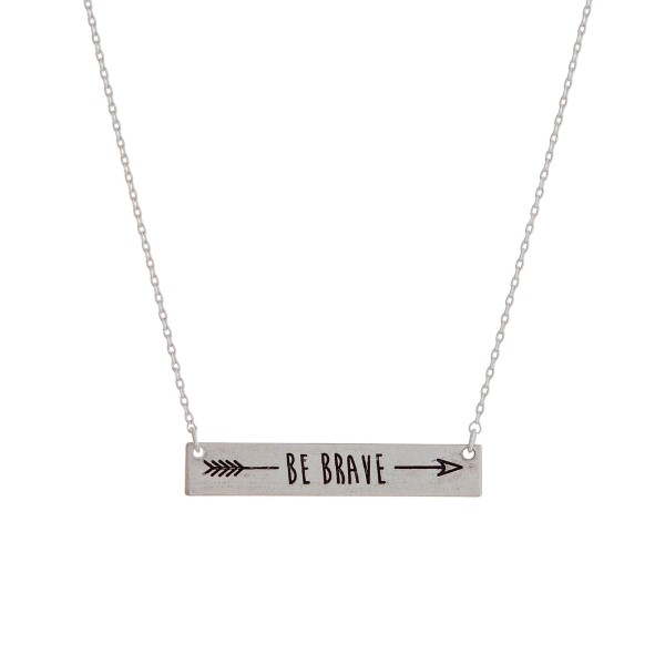 "Dainty silver tone necklace with a bar focal stamped with ""Be Brave"" and an arrow. Approximately 16"" in length."