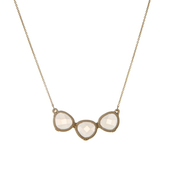 """Dainty gold tone necklace displaying three white opal stones. Approximately 16"""" in length."""