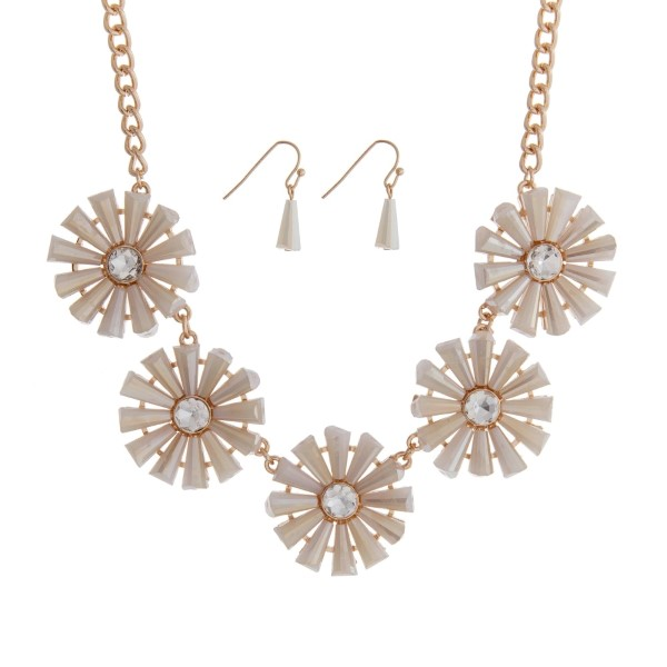 """Gold tone necklace set featuring five ivory flowers with clear rhinestones. Approximately 16"""" in length."""