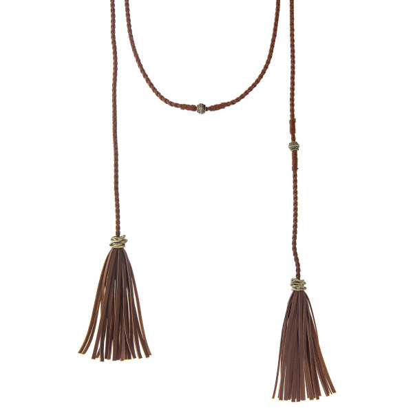 "Brown braided open wrap necklace with gold tone beads and tassels. Approximately 80"" in length."