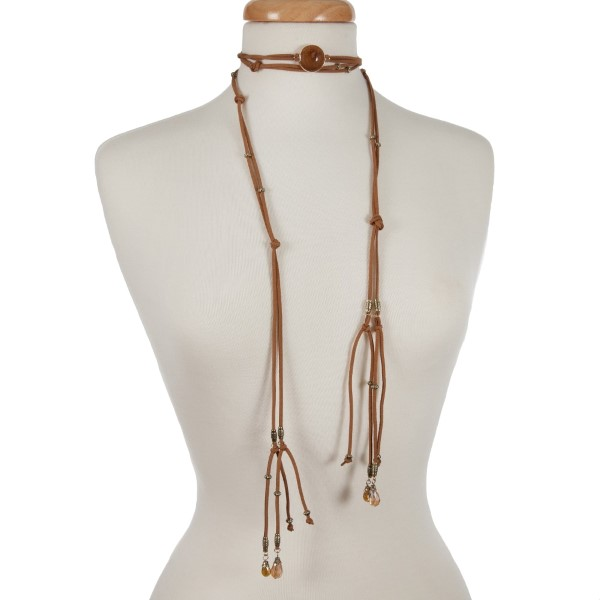 "Brown cord open wrap necklace with a beige stone and gold tone beads. Approximately 80"" in length."