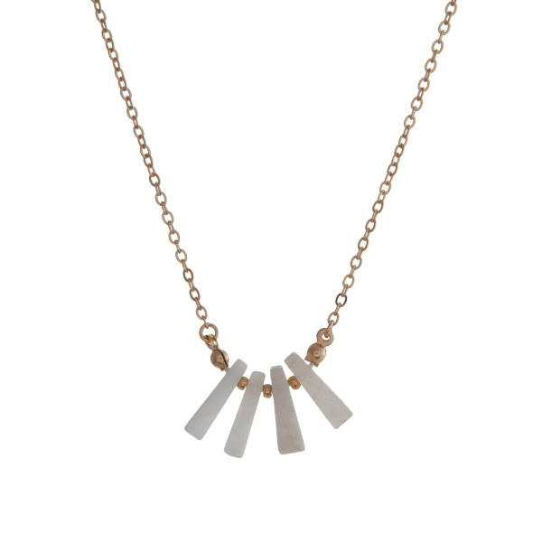 """Dainty gold tone necklace with white natural stones. Approximately 16"""" in length."""