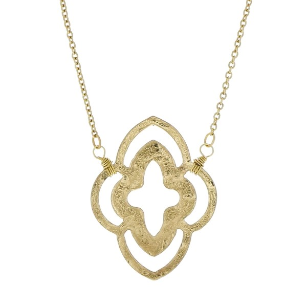 "Dainty gold tone necklace with a quatrefoil pendant. Approximately 18"" in length."