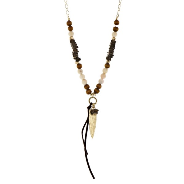 """Gold tone necklace with wooden and ivory beads and an arrowhead pendant. Approximately 32"""" in length."""