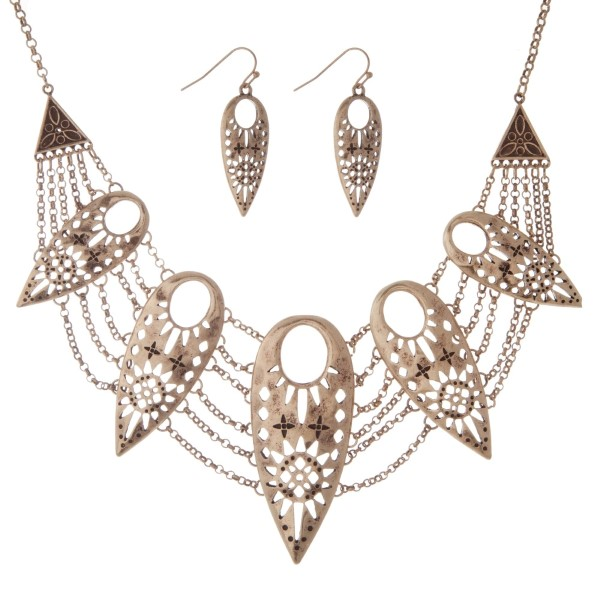 """Burnished gold tone necklace set with Aztec cutout teardrops and matching fishhook earrings. Approximately 16"""" in length."""