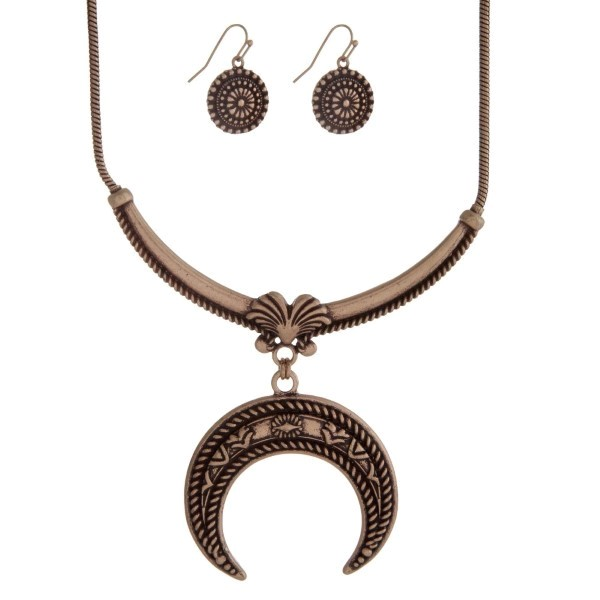 """Burnished gold tone necklace set with a squash blossom pendant and matching fishhook earrings. Approximately 18"""" in length."""