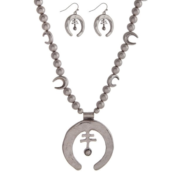 """Burnished silver tone necklace with crescent and squash blossom pendants. Approximately 32"""" in length."""