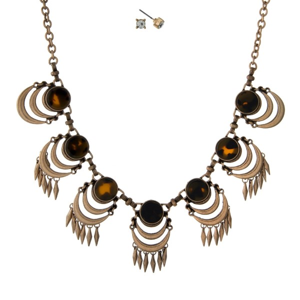 "Burnished gold tone necklace set with tortoise stones and matching stud earrings. Approximately 16"" in length."