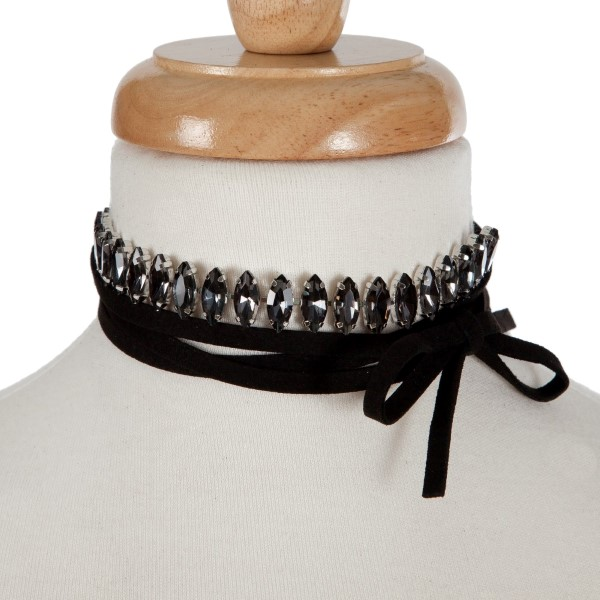 "Black suede wrap necklace with a silver tone choker displaying gray rhinestones. Approximately 70"" in length."