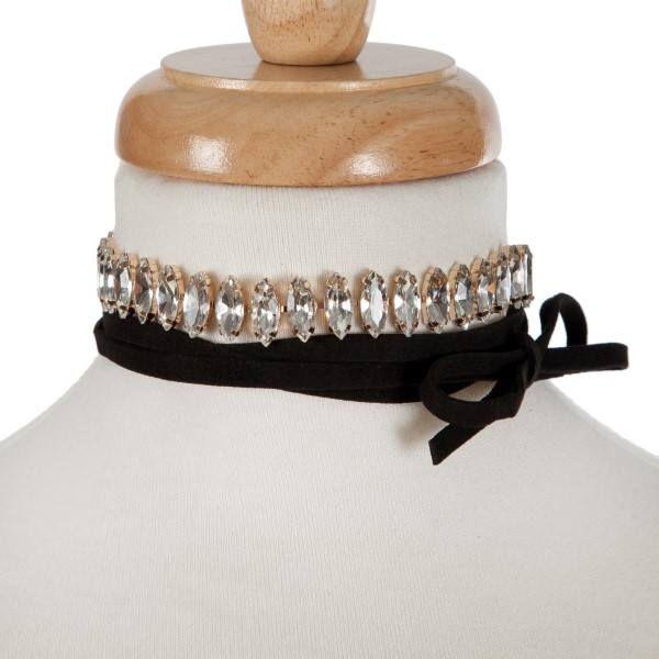 "Black suede wrap necklace with a gold tone choker displaying clear rhinestones. Approximately 70"" in length."