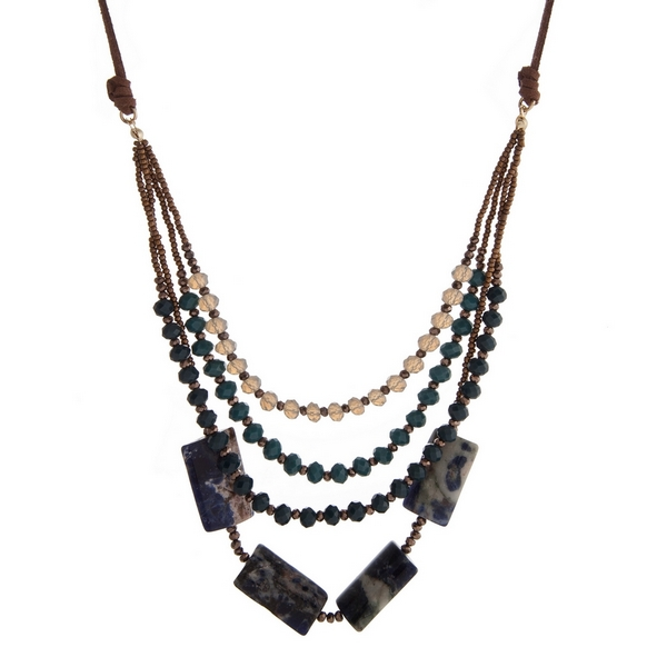 """Brown suede necklace with teal and gray faceted beads and lapis square beads. Adjustable up to 32"""" in length."""