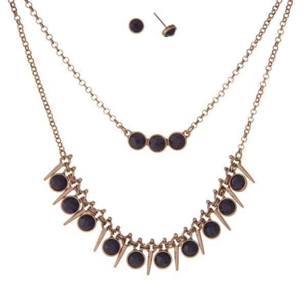 """Burnished gold tone double layer necklace set with navy blue faceted stones. Approximately 16"""" in length."""