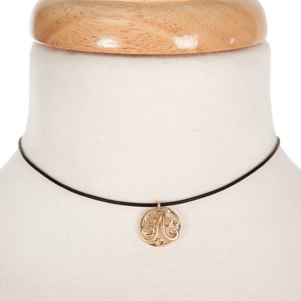 "Black waxed cord choker with a gold tone script 'A' initial. Approximately 12"" in length."