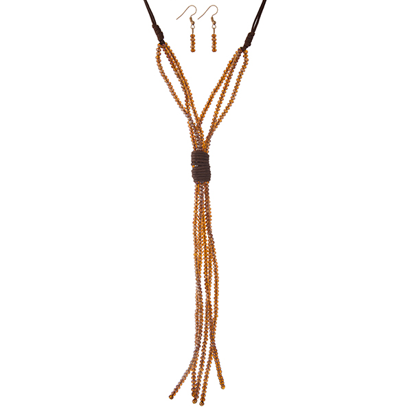 "Brown cord necklace set with a topaz and brown faceted bead tassel. Approximately 24"" in length."