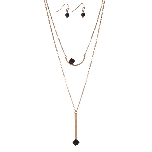 """Dainty gold tone necklace set with two black stone pendants and matching fishhook earrings. Approximately 16"""" in length."""