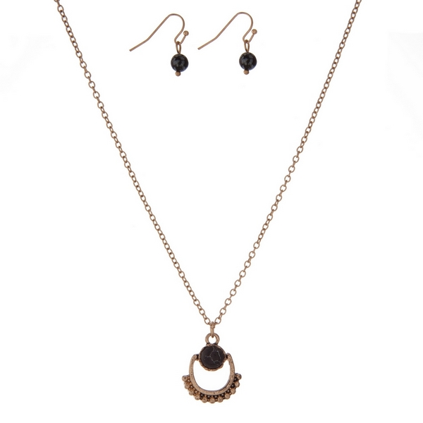 """Dainty gold tone necklace set with a black stone and matching fishhook earrings. Approximately 16"""" in length."""