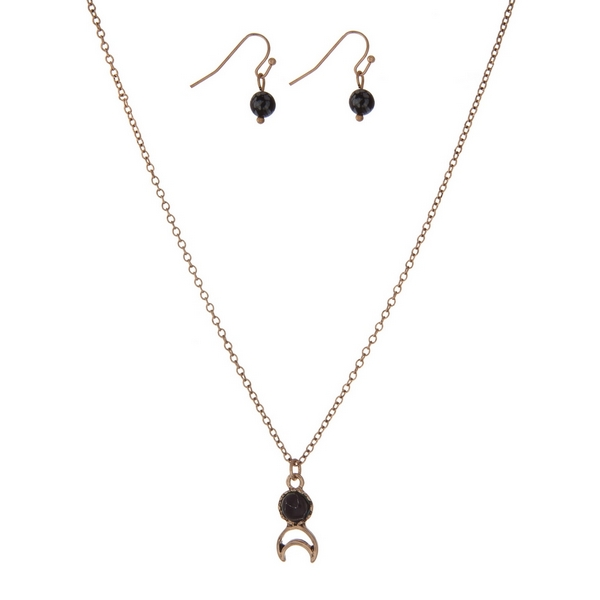 """Dainty gold tone necklace set with a black stone, a crescent cutout, and matching fishhook earrings. Approximately 16"""" in length."""