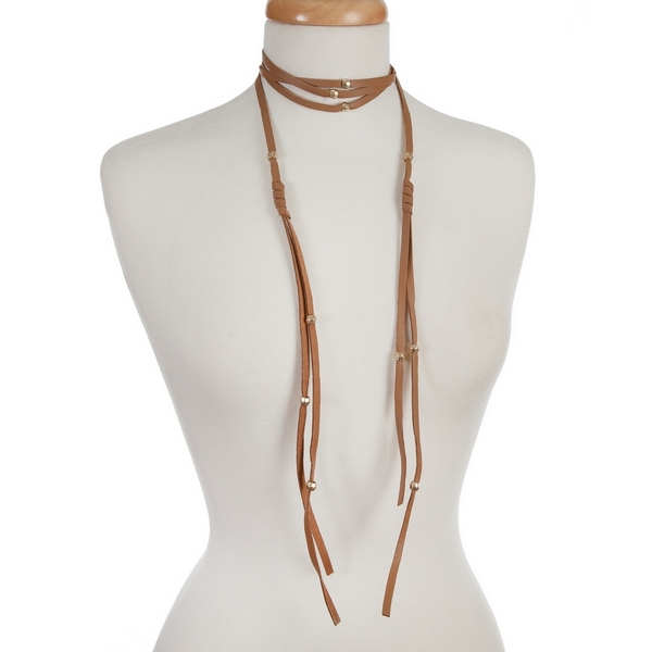 "Brown, faux leather wrap necklace with gold tone beaded accents. Approximately 84"" in length."